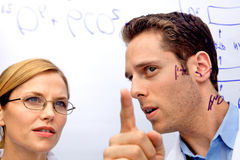 Two Scientists Working out a problem Royalty Free Stock Photography