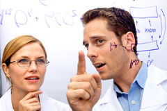 Two Scientists Working out a problem Royalty Free Stock Photos