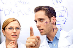 Two Scientists Working out a problem Stock Photos