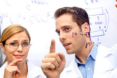 Two Scientists Working out a problem Royalty Free Stock Image