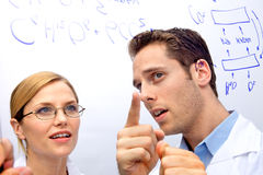 Two Scientists Working out a problem Royalty Free Stock Images