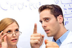Two Scientists Working out a problem Stock Photography
