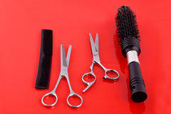 Two Scissors hairdressing scissors and hairbrushes Royalty Free Stock Photos