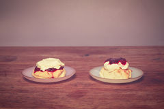 Two scones with cream and jam Royalty Free Stock Images