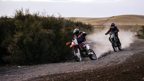 Two scrambler bikes racing on a dirt track Royalty Free Stock Images