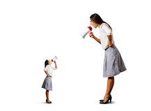 Two screaming woman with megaphone Royalty Free Stock Images