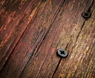 Two screw in old wood Stock Photos