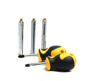 Two screwdrivers and three anchors Royalty Free Stock Photos