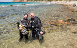 Two Scuba Divers. Avlaki,Greece - June 15 2006 : Two scuba divers ready to dive at a local dive site Royalty Free Stock Photography