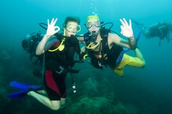 Two scuba divers on a dive. Looking happy Stock Image