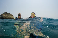 Two scuba divers on surface. Male and female scuba divers on surface Stock Photography