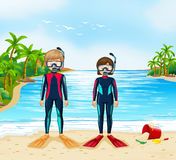 Two scuba divers in wetsuit standing on beach Stock Photo