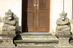 Two sculpture in front of balinese house royalty free stock image