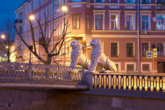 Two sculptures of lions on the Lion's bridge in night landscape. St. Petersburg Royalty Free Stock Photography