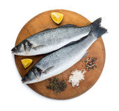 Two sea bass fish. On cutting board Stock Photo