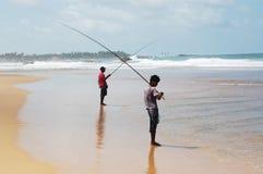 Two sea fisherman's on coast Stock Photos