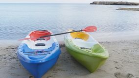Two kayaks on the beach. Two sea kayaks on the beach stock video