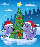 Two seals with Christmas tree Stock Photography