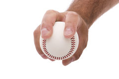 Two seam fastball grip. Demonstrating the two seam fastball grip on a baseball Stock Images