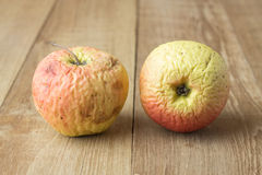 Two sear apple on wood background. Photo royalty free stock image