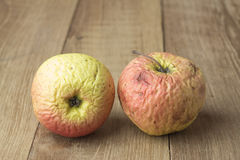 Two sear apple on wood background. Photo stock images