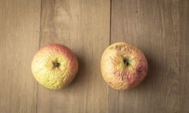 Two sear apple on wood background Stock Photography