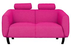 Two-seat pink fabric sofa isolated on white background royalty free stock photography