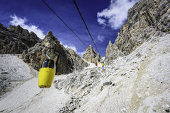 Two-seater cable car to Forcella Staunies Royalty Free Stock Image