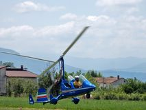 Two-seater Magni Gyro landing. Faicchio, Campania, Italy - 10 June 2018: A two-seater autogyro of the Magni Gyro just landed in Macchia on the occasion of the royalty free stock photo