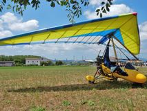 Two-seater motorized hang glider. Faicchio, Campania, Italy - 10 June 2018: Two-seater motorized hang glider on display at Macchia on the occasion of the first stock image