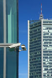 Two sec cameras on glass facade Stock Photography