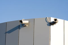 Two security cameras. On a wall Royalty Free Stock Images
