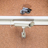 Two security cameras on the brick Stock Photography