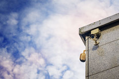 Two Security cameras on the side of an modern building Stock Photos