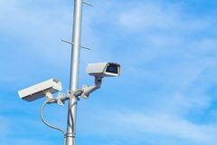 Two security cctv cameras on pole. Two security cctv cameras on pole Royalty Free Stock Image