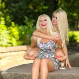 Two seductive blonde girl friends. Stock Images