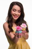 Two seductive cupcakes with eatable flowers royalty free stock photography