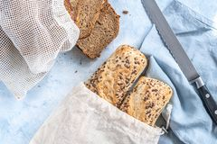 Free Two Seeded Chiabattas And Slices Of Bread In A Zero Waste Cotton Bag On A Beautiful, Clean, Rustic, Blue Background With A Linen Royalty Free Stock Image - 158414616