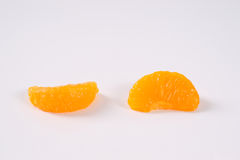 Two segments of peeled tangerines Royalty Free Stock Photography