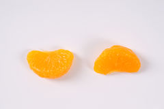 Two segments of peeled tangerines Stock Images