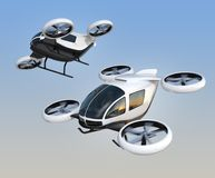 Two self-driving passenger drones flying in the sky. 3D rendering image Royalty Free Stock Photo