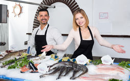 Two sellers in fish section of supermarket Stock Images