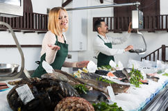 Two sellers in fish section of supermarket Royalty Free Stock Images
