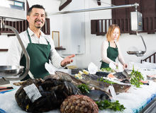 Two sellers in fish section of supermarket Stock Photography