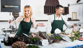 Two sellers in fish section of supermarket Royalty Free Stock Photography
