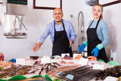 Two sellers in fish store Royalty Free Stock Photo