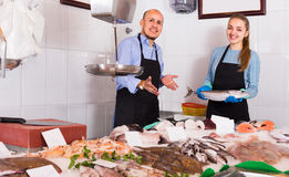 Two sellers in fish store Royalty Free Stock Image