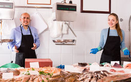Two sellers in fish store Stock Images