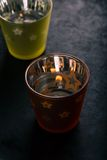 Two semi transparent cups with candle inside Royalty Free Stock Image