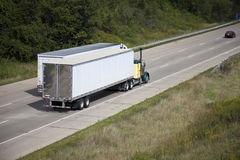 Two semi trucks on the highway Stock Image